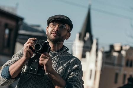Photo for Handsome adult man with vintage film camera in old european town - Royalty Free Image