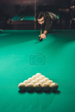 view of cropped man playing in russian pool at bar