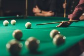 side view of cropped man playing in russian pool at bar