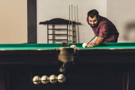handsome caucasian man playing in russian pool