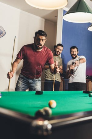 handsome frightened man scored black ball number 8 in pool