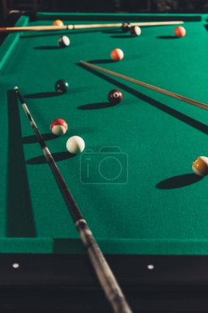 billiard gambling table with cues and balls