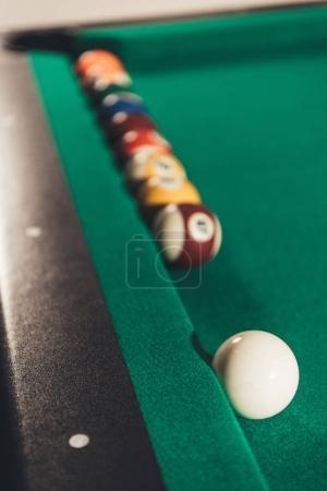 closeup billiard balls on gambling table