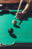 cropped image of man playing in pool