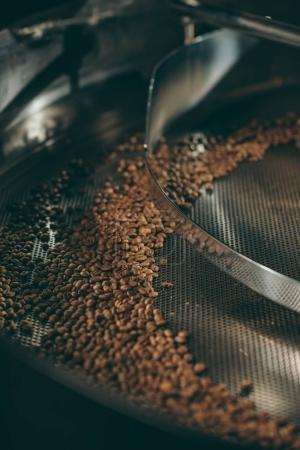 Photo for Close up view of coffee beans roasting in machine - Royalty Free Image