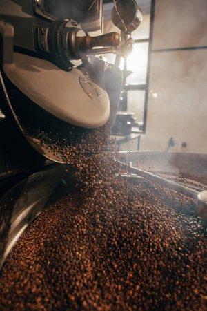 close up view of coffee beans roasting in machine
