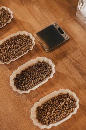 close up view of arranged bowls with coffee beans for food function on wooden tabletop