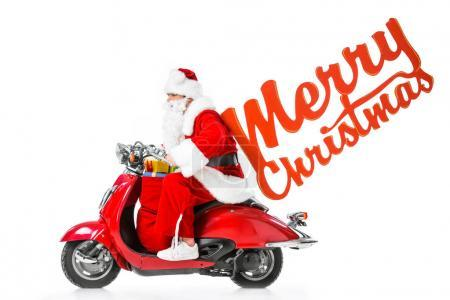 Santa Claus with big red bag full of gifts riding red scooter, isolated on white with Merry Christmas sign