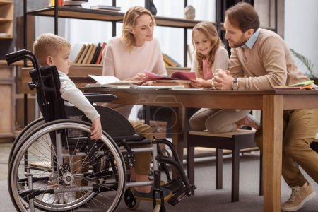 happy parents teaching children at home