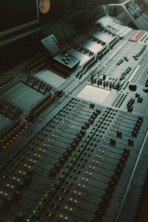 modern analog graphic equalizer at sound recording studio