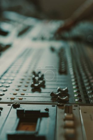 close-up shot of analog graphic equalizer at recording studio