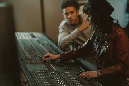 Photo for Sound producers working with graphic equalizer at recording studio - Royalty Free Image