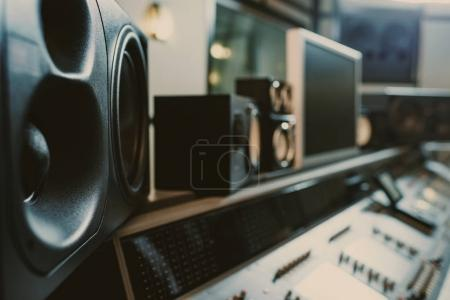 close-up shot of dynamic monitors at recording studio