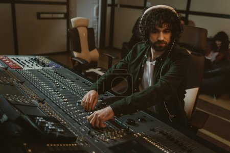 Photo for Focused young sound producer working at studio - Royalty Free Image
