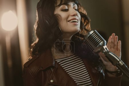 beautiful young singer performing song and smiling