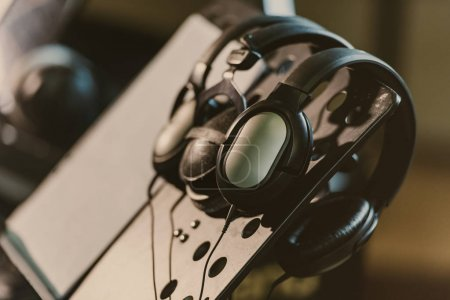 Photo for Close-up shot of headphones hanging on music stand - Royalty Free Image