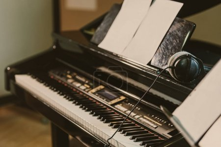 close-up shot of electric piano in sound recording studio