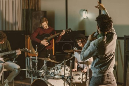 rock music band playing at studio together