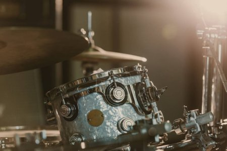 close-up shot of drum set under spotlight on stage