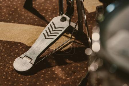 close-up shot of drum pedal on carpet