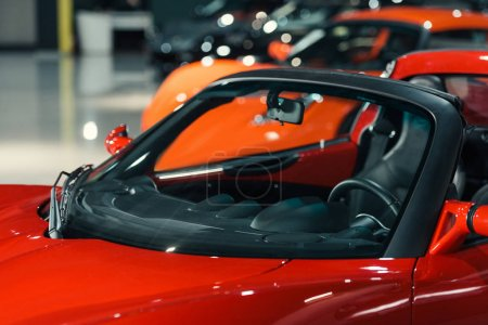 sport cars standing in row at car showroom