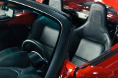 cropped shot of new red sport car interior