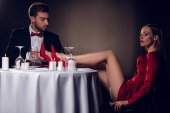 attractive sexy girlfriend sitting at table with her boyfriend