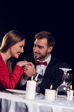 beautiful smiling couple spending time on romantic date in restaurant