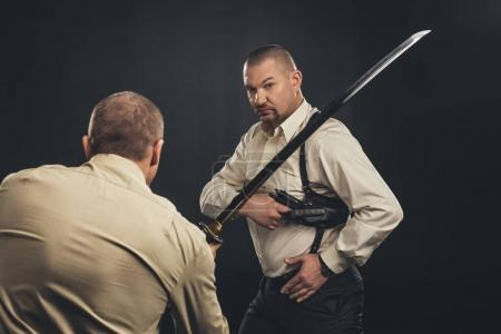 mafia members fighting with gun and katana sword on black