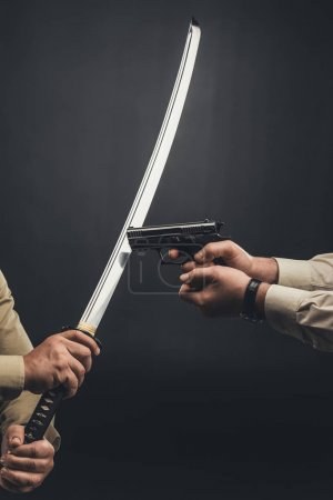 yakuza members fighting with gun and katana sword on black