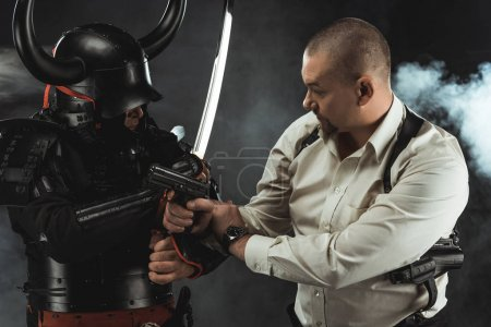 armored samurai fighting with modern man in shirt who holding gun