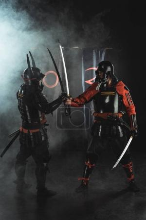 samurai in traditional greeting each other on black