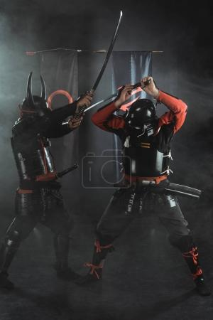 traditional armored samurai fighting with swords on black