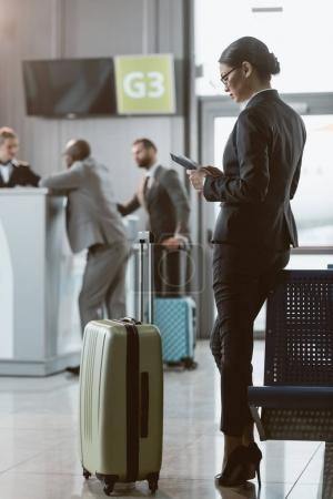 Photo for Attractive businessman waiting for flight at airport lobby - Royalty Free Image
