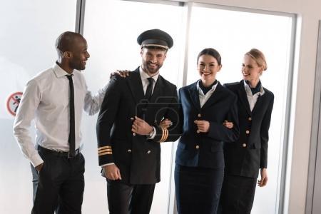 happy aviation personnel team in professional uniform