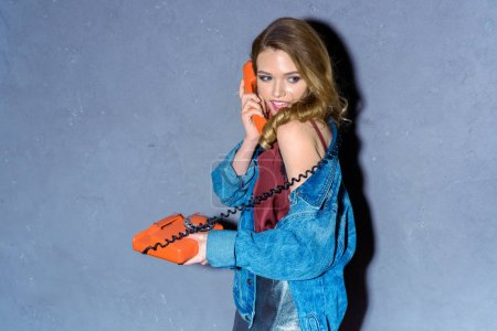 young woman with retro telephone