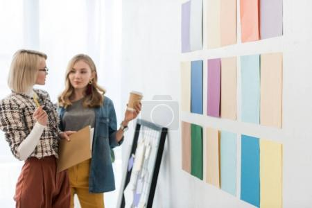 fashionable magazine editors working with color palette on wall