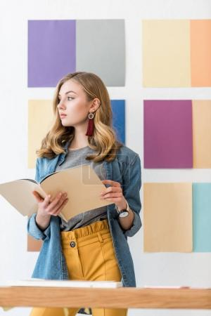 young magazine editor with color palette behind