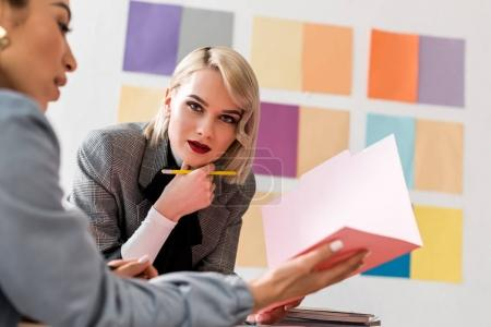Photo for Multiethnic fashionable magazine editors working in modern office - Royalty Free Image