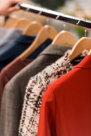 Photo for Close up view of fashionable clothes on hangers - Royalty Free Image