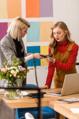 fashionable businesswomen working in modern office