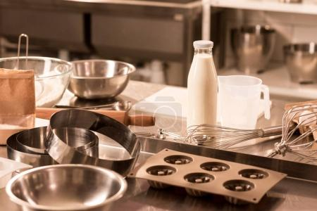 Photo for Close up view of ingredients for dough and kitchen utensils on counter in restaurant - Royalty Free Image