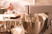 selective focus of confectioner and food processor whipping cream