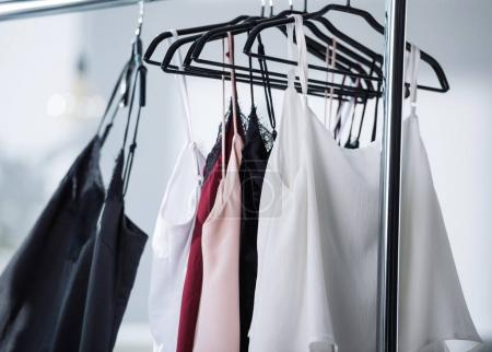 Photo for Close-up shot of various dresses hanging on rack - Royalty Free Image
