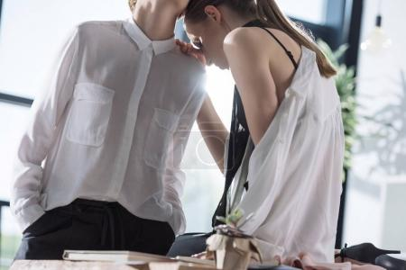 young fashionable lesbian couple at office