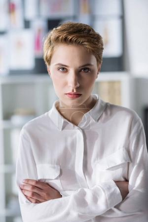 close-up portrait of stylish young woman in white shirt
