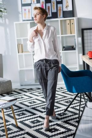 attractive young fashion designer at modern office