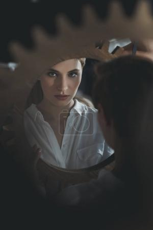 Photo for Beautiful young woman looking at camera through mirror reflection - Royalty Free Image