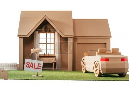 Photo for Cardboard house and car with sign sale isolated on white - Royalty Free Image