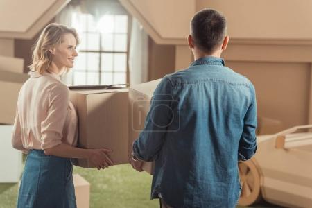 adult couple moving into new cardboard house
